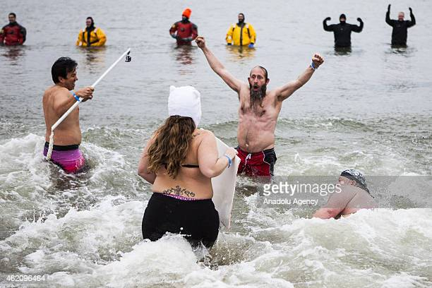 The first people into the frigid water celebrate at the 19th Annual Maryland State Police Polar Bear Plunge at Sandy Point State Park in Annapolis Md...