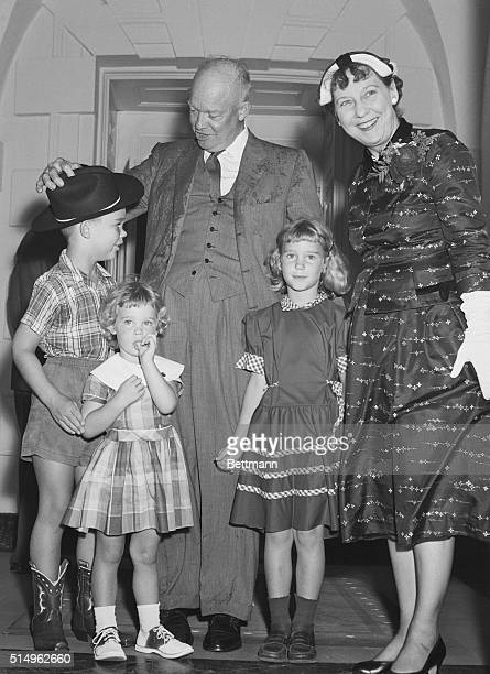 The first persons on hand to greet President and Mrs Eisenhower upon their return from Geneva are their three grandchildren David age 8 Susan age 5...