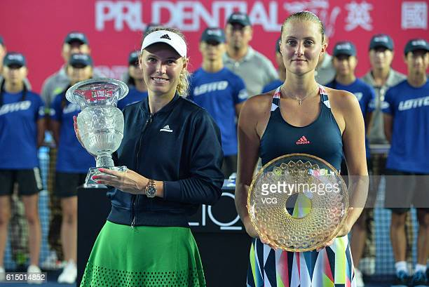 The first place Caroline Wozniacki of Denmark and the second place Kristina Mladenovic of France pose with the trophies after the Women's single...