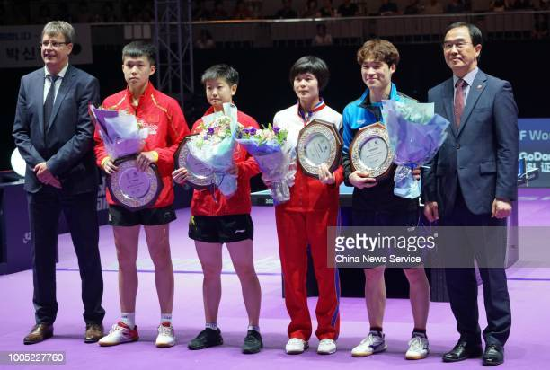 The first place Jang Woojin of South Korea and Cha Hyo Sim of North Korea and the runnerup Sun Yingsha and Wang Chuqin of China pose after the Mixed...