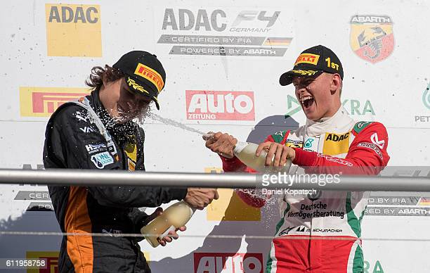 The first placed Mick Schumacher celebrates with the second placed Kami Laliberte after the third race during ADAC Formula 4 at Hockenheimring on...
