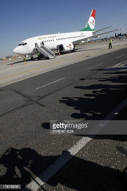 The first plane of the new Hungarian airline 'Solyom' is pictured after it landed at the Budapest Liszt Ferenc International Airport on August 18...