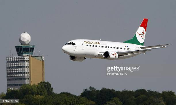 The first plane of the new Hungarian airline 'Solyom' prepares to land at the Budapest Liszt Ferenc International Airport on August 18 2013 The...