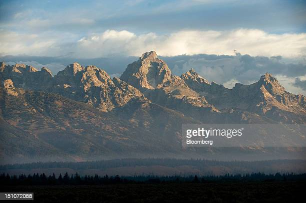 The first rays of sunlight hit the Teton Mountain Range as the economic symposium sponsored by the Kansas City Federal Reserve Bank begins at the...