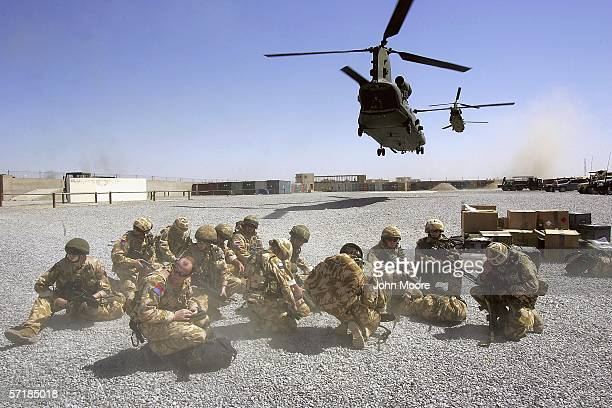 The first regular British troops of the Helmand Task Force arrive by helicopter to an American-run base on March 26, 2006 in Lashkar Gah, in the...