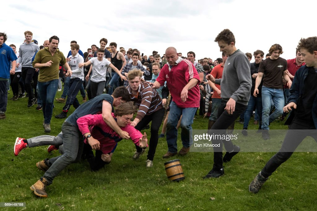 The first round of the bottle Kicking gets underway over the Hare Pie Hill on April 17, 2017 in Hallaton, England. Hallaton hosts the Hare Pie Scramble and Bottle Kicking event today. The Bottle Kicking follows the Hare Pie Scramble, two events that are combined to form an ancient custom that dates back to the early eighteenth century, and one of the oldest in British History. The first part consists of a blessing of a Hare Pie by a local vicar, before it is cut up and thrown to the crowd, who 'scramble' to get a piece, believing it will bring good luck. The second part, the Bottle kicking sees two rival villages, Hallaton, and neighboring Medbourne attempt to carry a 'bottle' which is actually a keg of beer, from the Hare Pie Bank, and get it across a boundary stream for their own village. The best of three contest can last several hours.