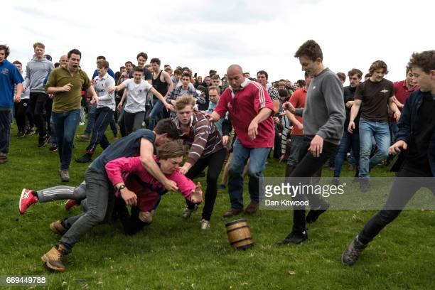The first round of the bottle Kicking gets underway over the Hare Pie Hill on April 17 2017 in Hallaton England Hallaton hosts the Hare Pie Scramble...
