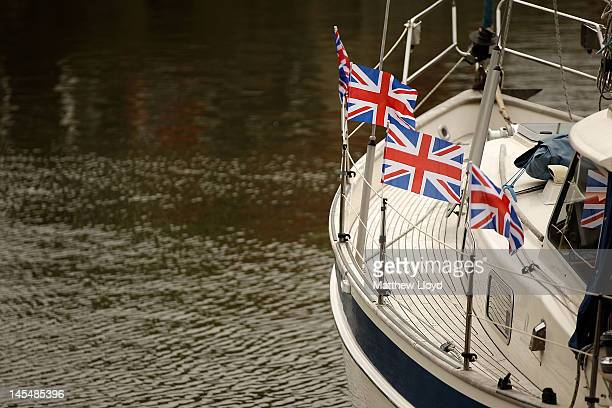 The first sailing boats are anchored in position at St Katharine Docks downstream of Tower Bridge ready to form the Avenue Of Sail which the Queen's...