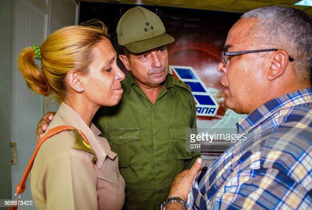TOPSHOT The first secretary of Communist Party in the Cuban city of Holguin Luis Antonio Torres Iribar speaks with a relative of one of the victims...