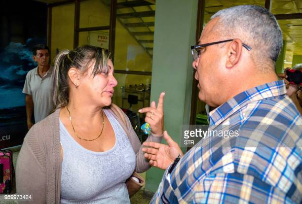 The first secretary of Communist Party in the Cuban city of Holguin Luis Antonio Torres Iribar speaks with a relative of one of the victims of the...