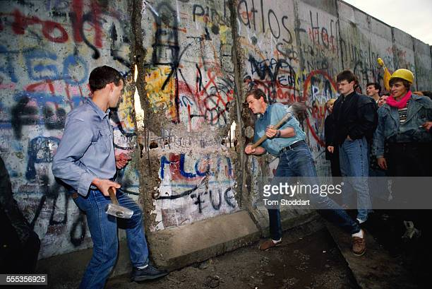 Picture shows Henning Pless hammering at the Berlin Wall near the Brandenburg Gate on the morning of November 10 1989 Pless was one of the leaders of...