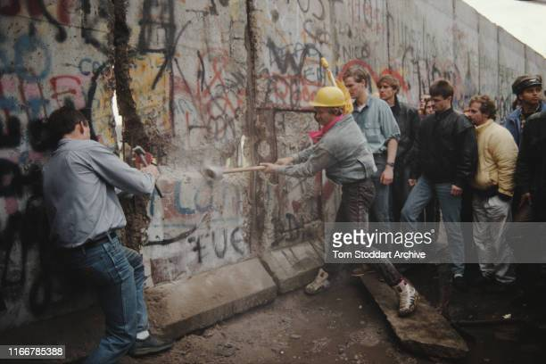 The first section of the Berlin Wall is torn down by crowds on the morning of 10th November 1989 The area around the breach was later secured by West...