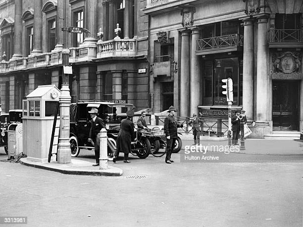 The first set of traffic lights being used at a junction in Piccadilly, London.