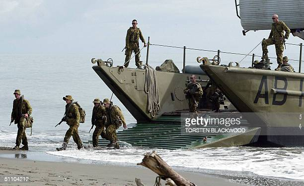 The first soldiers of the Australianled intervention force based on the HMAS Manoora come ashore at Red Beach for 'Operation Helpem Fren' near...