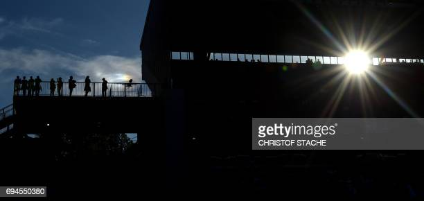 TOPSHOT The first spectators stand at a tribune prior to the FIFA World Cup 2018 qualification football match between Germany and San Marino in...