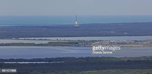 The first stage of a SpaceX Falcon 9 rocket returns to Cape Canaveral on Monday Aug 14 2017 after lifting off from launch pad 39A a few minutes...