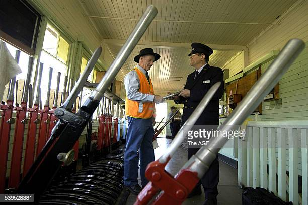 The first steam train on the newly opened Victorian Goldfields Railway leavingt Castlemain railway station as signalman Keith Nelson L takes the...