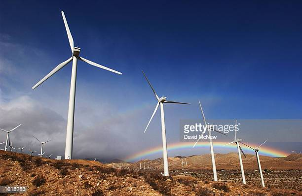 The first storm of the season produces a rainbow behind wind turbines in the San Gorgonio Pass November 9, 2002 near Palm Springs, California.
