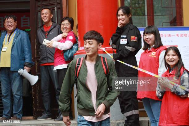 The first student walks out of exam room after the first test of national college entrance examination at Harbin No3 High School on June 7 2017 in...