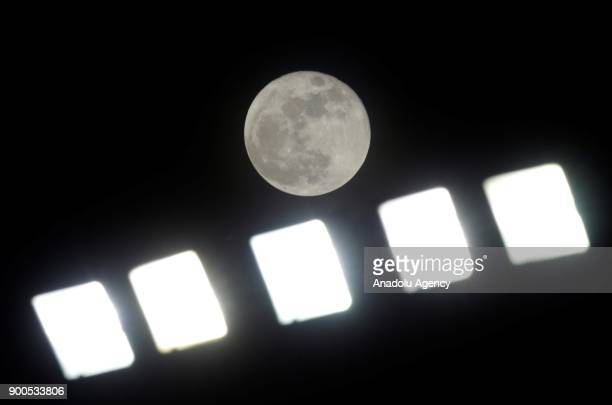 The first supermoon of 2018 is seen behind spotlights in Ankara Turkey on January 02 2018 A supermoon is a full moon or a new moon that approximately...