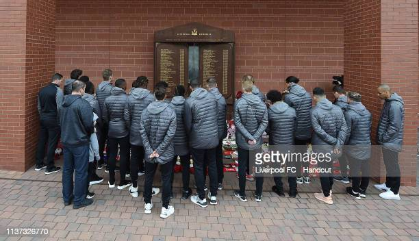The First Team of Liverpool pay their respects at the Hillsborough Memorial at Anfield to mark the 30th anniversary of the Hillsborough disaster on...