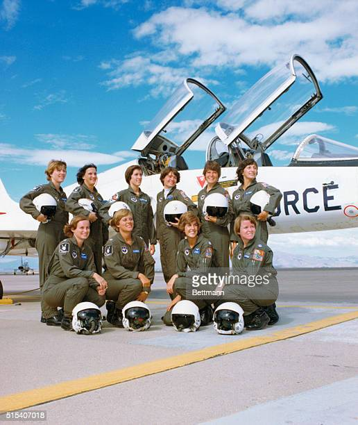 The first ten women to enter Undergraduate Pilot Training in the history of the Air Force line up in front of a T38 Talon training aircraft They are...