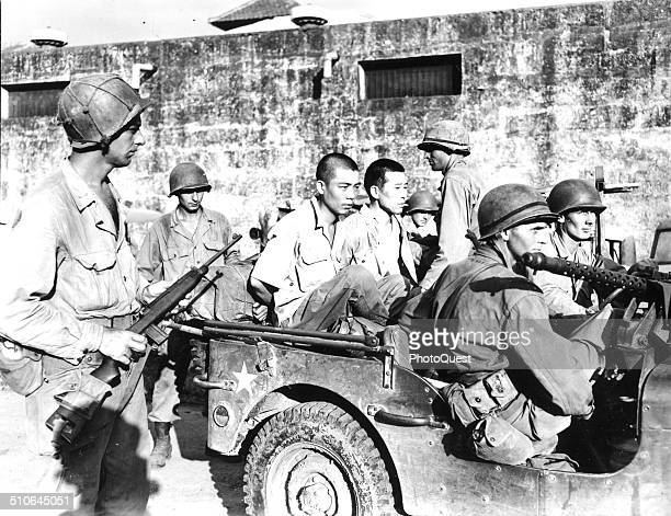 The first uniformed Japanese troops captured by American troops wait in a jeep before being questioned Manila Philippines February 1945