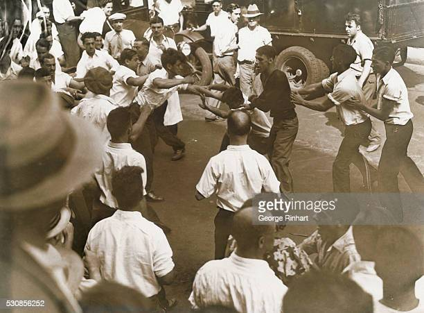 The first violence occurred in the silk strike here a few hours before several hundred workers responded to the strike call of the United Textile...