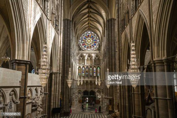 The first visitors to pass through the doors at Westminster Abbey are seen as it re-opens to the public, on July 11, 2020 in London, England....