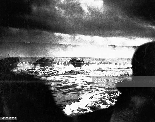 The first wave of allied landing craft heads toward the Normandy beaches on DDay