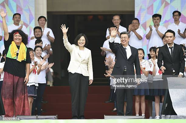 The first woman President of Taiwan Tsai Ingwen waves her hand during a swearingin ceremony at presidential palace in Taipei Taiwan on May 20 2016