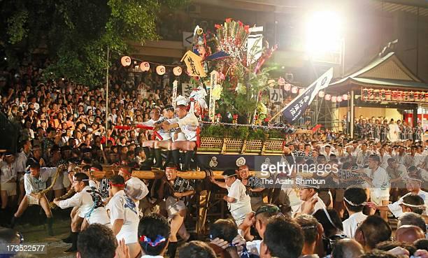 The first 'Yamakasa ' race through Seido Street of Kushidajinja Shrine during the Hakata Gion Yamakasa festival on July 15 2013 in Fukuoka Japan The...
