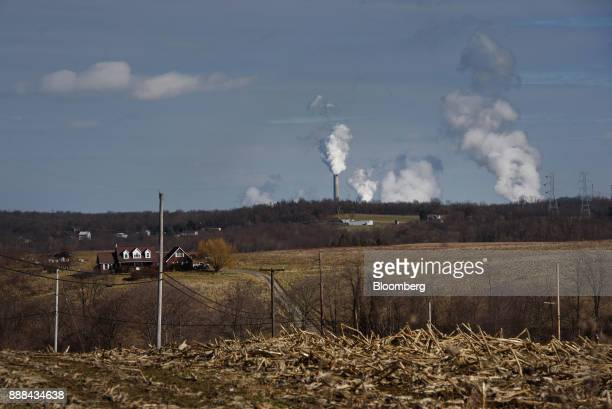 The FirstEnergy Corp. Bruce Mansfield coal-fired power plant stands past a farm house in Shippingport, Pennsylvania, U.S., on Wednesday, Dec. 6,...