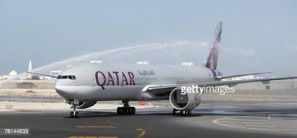 The firstever Boeing aircraft 777 delivered to the stateowned Qatar Airways stands on the runway at Doha airport 29 November 2007 Earlier this month...