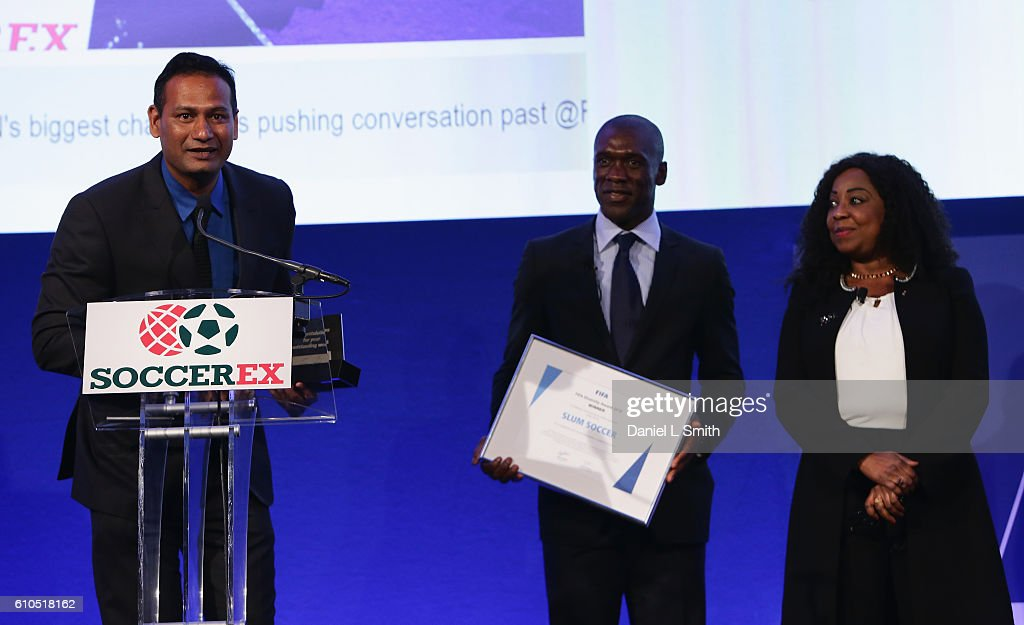 The first-ever FIFA Diversity Award is presented to Abhijeet Barse from Slum Soccer by Fatma Samba Diouf Samoura, FIFA Secretary General and Clarence Seedorf, former Netherlands International during day 1 of the Soccerex Global Convention 2016 at Manchester Central Convention Complex on September 26, 2016 in Manchester, England.