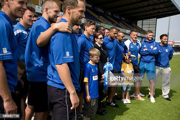 The first-team squad of Mansfield Town lining up for a team photograph with the Conference National trophy at Field Mill stadium during an open day...