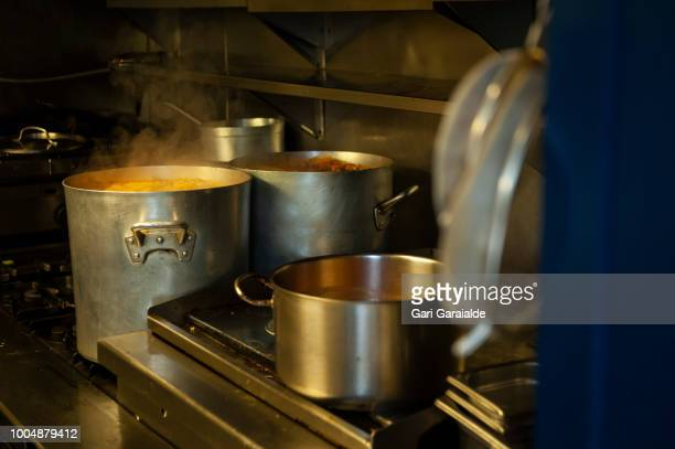 The fish soup being cooked in two large pots on July 20 2018 in Hondarribia Spain The restaurant Hermandad de Pescadores became famous when in 2011...