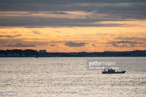 The fishing boat sailing on Kamakura and Sagami Bay in Japan in the morning