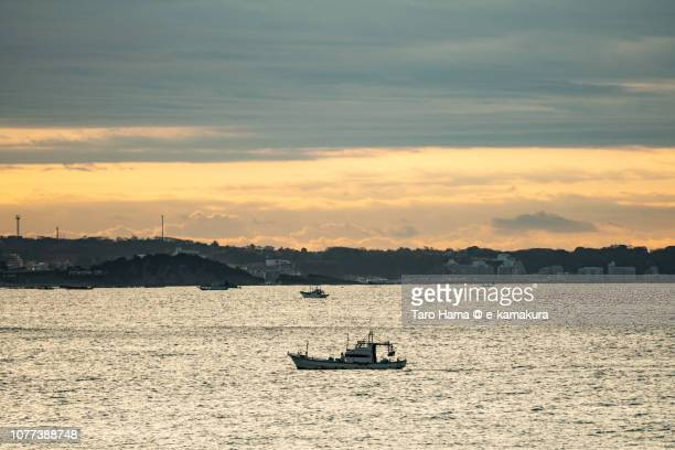 The fishing boat sailing on Sagami Bay in Japan in the morning