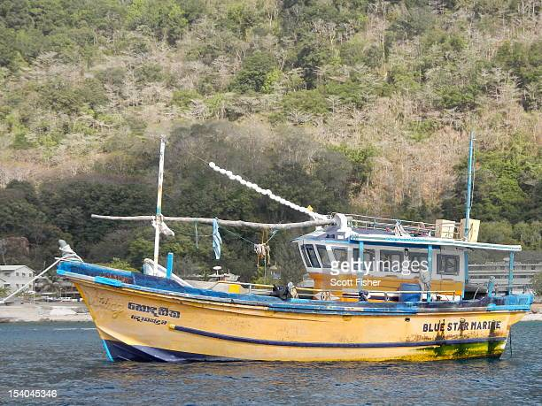 The fishing boat that suspected asylum seekers used to arrive on Christmas Island is prepared to be towed further out to sea and destroyed on October...