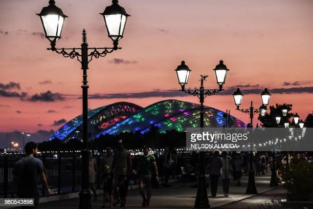 TOPSHOT The Fisht Olympic Stadium is seen at summer solstice's dusk in Sochi on June 21 during the Russia 2018 World Cup football tournament