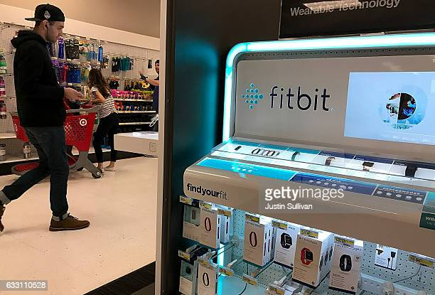 The Fitbit logo is displayed at a Target store on January 30 2017 in Los Angeles California Fitbit announced that it will lay off 110 employees or 6...