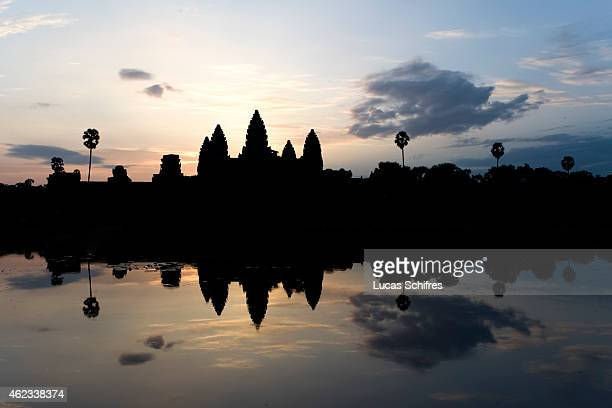 The five lotusshaped towers of Angkor Wat temple stand at sunrise on October 8 2009 in Angkor Cambodia Angkor Wat is a temple complex at Angkor built...