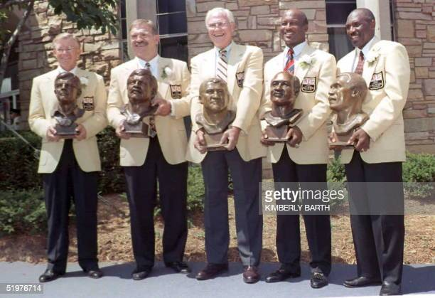 The five newlyinducted members of the Pro Football Hall of Fame in Canton Ohio stand with their busts in front of the Hall of Fame 27 July after...