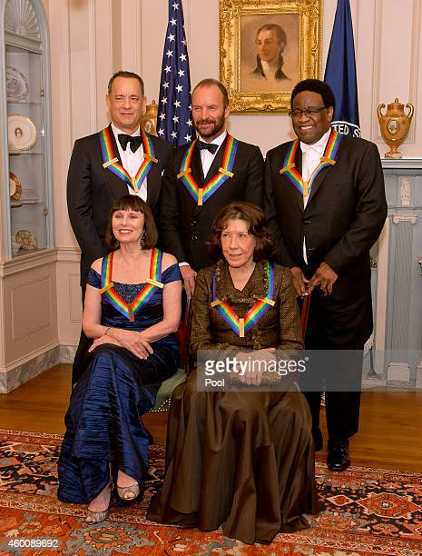 The five recipients of the 2014 Kennedy Center Honors pose for a group photo following a dinner hosted by United States Secretary of State John F....