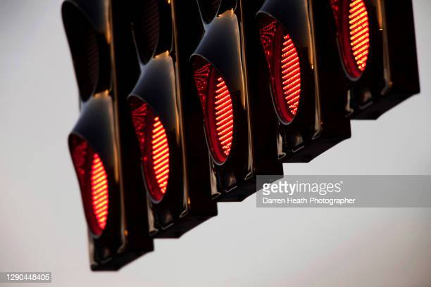 The five red start lights on the overhead gantry positioned on the start and finish straight at the 2010 British Grand Prix, Silverstone Circuit,...
