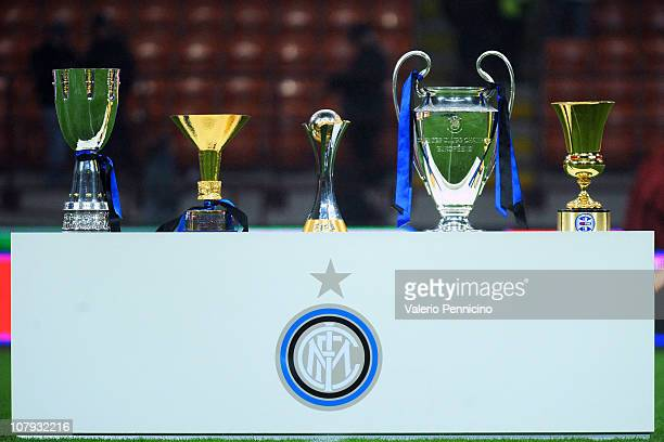 The five trophies the Supercoppa Italiana the Scudetto trophy the FIFA Club World Cup trophy the Champions League trophy and the Coppa Italia won by...