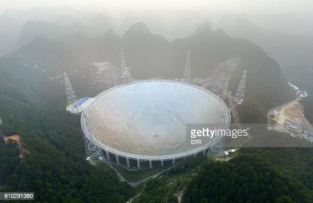 TOPSHOT The Fivehundredmetre Aperture Spherical Radio Telescope is seen on its first day of operation in Pingtang in southwestern China's Guizhou...