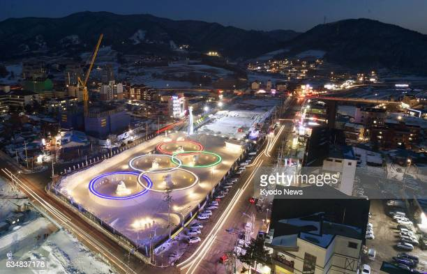 The fiveringed symbol of the Olympic Games is lit up at a snow festival in Pyeongchang on Feb 6 about one year before the start of the Winter...