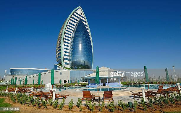 The five-star hotel Yyldyz built by French Bouygues group rises in the Turkmenistan's capital Ashgabat on October 16, 2013. AFP PHOTO